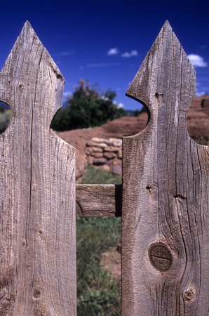 Close-up of two weathered wooden fence posts mostly obscuring view of the yard. Could represent the login area of a website. Stock Photo - 11410468