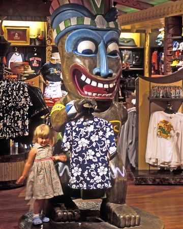 Child at clothing display of gift shop in Polynesian Resort, Disney World, Orlando, Florida, USA. Stock Photo - 11593506