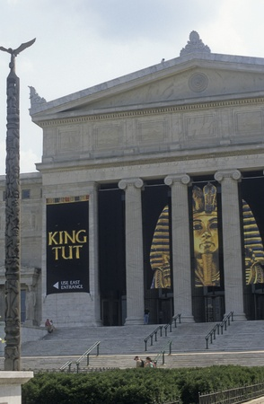 Field Museum of Natural History exterior in Chicago, Illinois, USA, with totem pole and banner for King Tut museum display. Stock Photo - 11593528