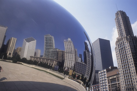 Chicago buildings reflected in the Cloud Gate sculpture in Grant Park, USA.