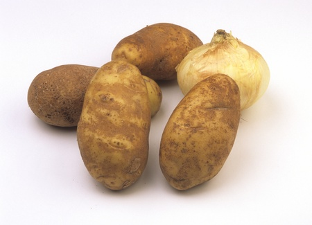 Arrangement of four Idaho potatoes and one Vidalia onion. Stock Photo
