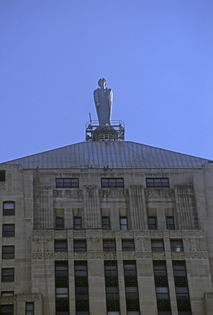 Exterior of Chicago Board of Trade building with Sculpture on top in downtown Chicago, Illinois.