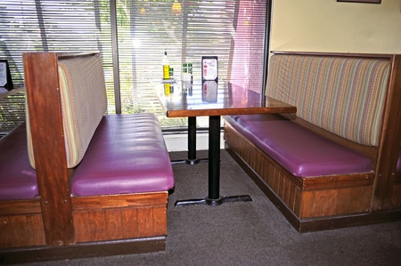 Sarasota, Florida, USA, December 2011. Empty booth in Madfish Grill restaurant.