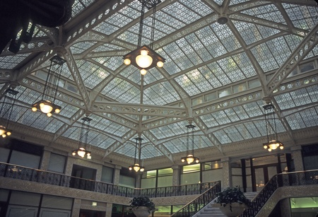 Glass ceiling in large office building lobby.