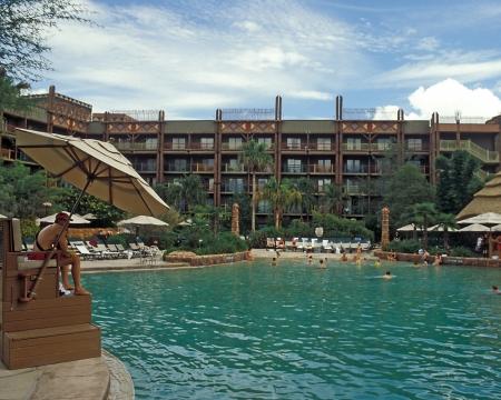 Lifeguard watches tourists swimming in Disney Animal Kingdom Lodge swimming pool, Orlando, Florida. Editorial