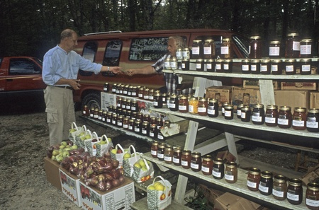 a jar stand: Farmer selling goods at roadside stand in The Smokey Mountains NC Editorial
