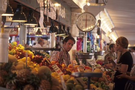 Grocer selling produce Pike Place Market Seattle Stock Photo - 12001288
