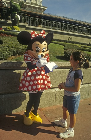 autograph: Disney World Magic Kingdom - Minnie Mouse signs autograph Editorial