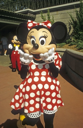 costumed: Disney World Magic Kingdom - Minnie Mouse with Mickey Mouse in background