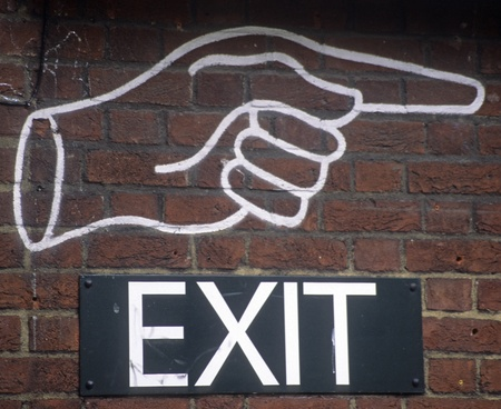 Closed fist with index finger pointing to the right showing where to exit. Stock Photo - 12034716