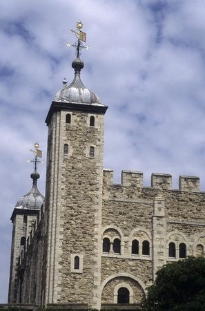 Exterior view of the Tower of London and its weather vane.