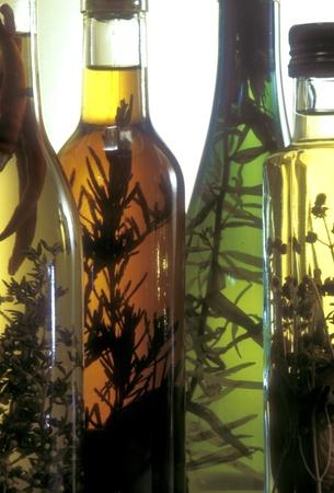 Pieces of herbs in vinegar bottles flavors the vinegar