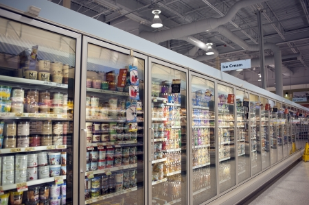 large store: Sarasota, Florida, USA,  Frozen food section of large grocery store with ice cream containers.