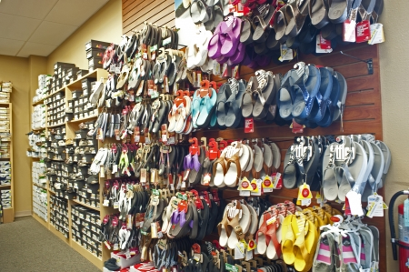 Sarasota, Florida, USA, July 2012, shopping at shoe store with thong sandals displayed on store wall. Editorial