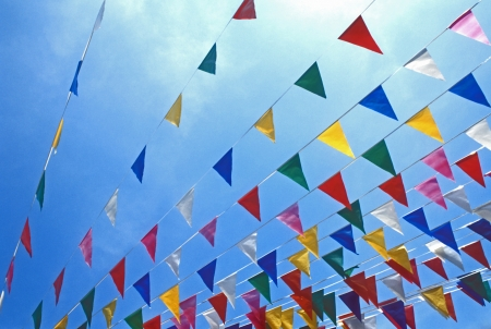 Exciting colorful flags fill the summer sky with a rainbow of red, white, pink, blue, yellow, and green