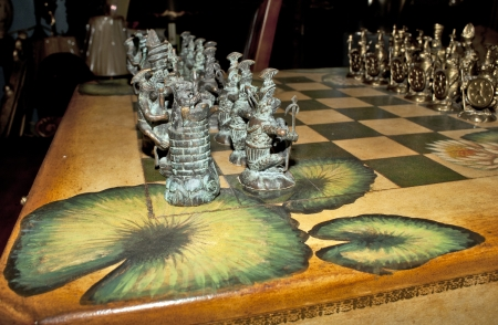 Chess game set up on table with interesting pattern design  Stock Photo
