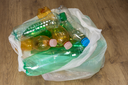 polycarbonate: Ecological separation of household waste. Empty pet bottles in a plastic bag. Stock Photo