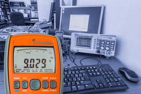 Digital multimeter at the electrotechnical workplace, DMM