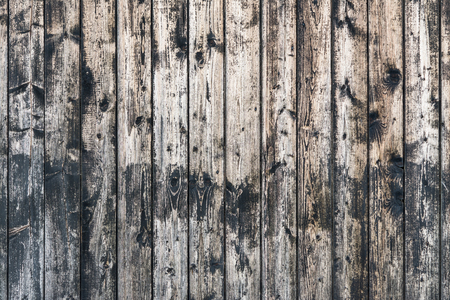 Vintage wooden background from planks with knots.