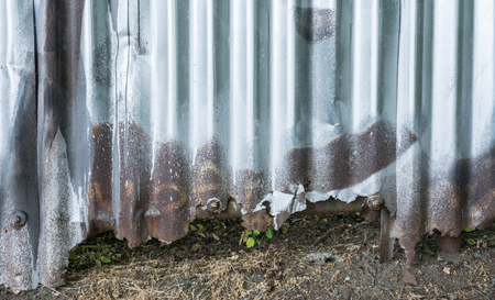 Background from old rusty corrugated iron. Destroyed city fence. Stock Photo