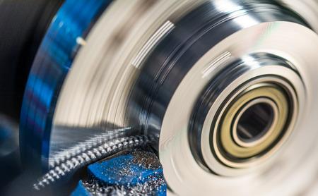 Rotating workpiece with metal splinter. Screwed swarf during turning of workpiece. Beautiful motion blur.