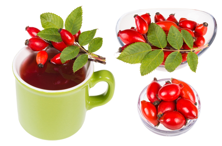 Set of rosehips on mug with hot tea and in glass bowls. Rosa canina. Collection of beautiful red briars with green leaves. Isolated on white background. Zdjęcie Seryjne - 89975445