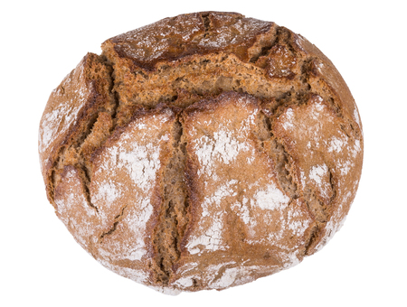 Small round loaf of brown bread with cracks. Fresh baked bread roll isolated on white background. Imagens