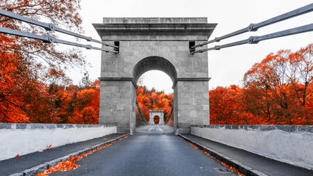 Empire chain bridge across the river Luznice, Stadlec, Czech Republic, Europe. National Technical Monument in beautiful autumn colors. Stock Photo