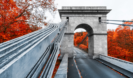 Empire chain bridge across the river Luznice, Stadlec, Czech Republic, Europe. Close-up of the steel links. National Technical Monument in rich autumn colors. Stock Photo