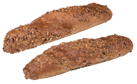 Wholegrain baguettes sprinkled with sunflower seeds. Two freshly baked crunchy bread rolls with a golden crust. Isolated on white background.