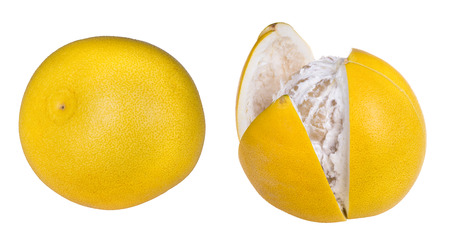 Close-up of two pomelos. Citrus grandis. Tropical citrus fruits with yellow peel, whole or partly cut open and peeled. Isolated on white background. Stock Photo