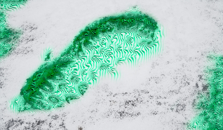 Imaginary malachite footprint in abstract snow surface. Bizarre footmark with imitation of a green mineral. Wavy ornamental pattern. Artistic background with imprint in foot shape. White ice texture.