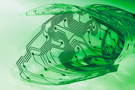 Electronic flex circuit board. Plastic membrane of computer keyboard inside. Green PCB curled to roll. Artistic detail. Transparent bent sheet. Abstract pattern. Round holes, dots, lines. Electronics.