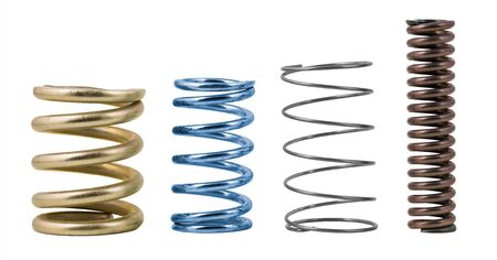 Four steel compression coil springs with varied surface finish isolated on white background. Springy metallic machine parts. Set of different flexible elastic shock absorbers with spiral wire winding.
