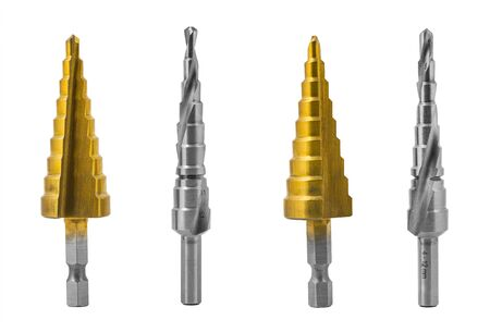 Conical step drill bits set isolated on white background. Silvery steel unibits with spiral or straight flutes for drilling different hole sizes. Golden titanium coating. Chip machining cutting tools. Stok Fotoğraf