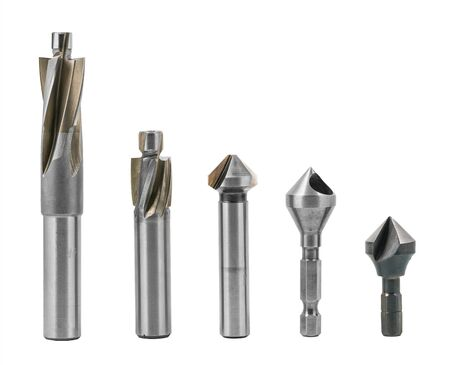 Set of counterbores and countersinks isolated on a white background. Steel cylindrical and conical fluted cutting tools for drilling countersunk or counterbored holes. Metal silvery machining cutters. Stok Fotoğraf