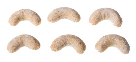 Vanilla crescent roll sweets. Set of fragrant baked pastries isolated on white background. Close-up of traditional Czech nutty cookies in shape of rolls dusted with icing sugar. Stok Fotoğraf