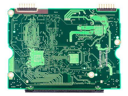 Green circuit board copper layer with connectors isolated on white background. Through-hole and surface-mount technology. PCB printed side with soldered electronic components. Electrical engineering.