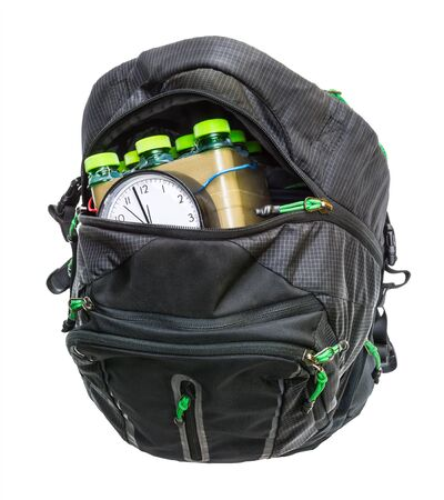 Time-bomb detail. Improvised explosive device in rucksack isolated on white background. Home-made timebomb inside of black baggage with open zip. Weapon for violent terrorist crime or suicidal attack.