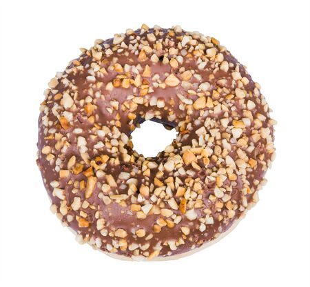 Baked donut decorated with nougat icing and crushed nuts isolated on a white background. One sweet doughnut from yeast leavened dough with round hole and cocoa glaze sprinkled by nut pieces. Top view.