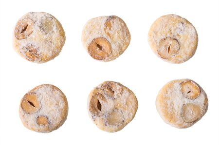 Set of shortbread cookies with sliced hazelnuts isolated on white background. Baked nuty circles sprinkled by vanilla powder sugar. Traditional Christmas and wedding sweets of Czech cuisine. Top view. 写真素材