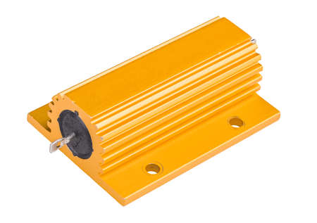 Single power resistor in yellow cooling outer case isolated on a white background. Close-up of a metal encased passive electronic component with heat sink of anodized aluminum. Electrotechnic element. Banque d'images