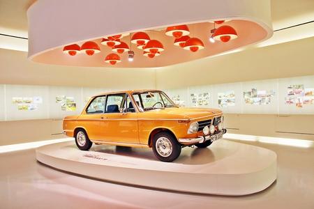 bmw: Munich, Germany - April 12, 2012: Display of BMW 2002 TI, year 1968 at BMW Welt in Munich, Germany