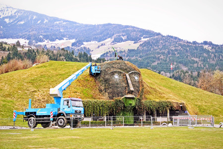 WATTENS, AUSTRIA - April 7, 2012: Entrance to the Swarovski Crystal Worlds (Kristallwelten) museum. The green giant face was under construction.