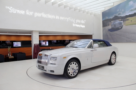 strive: Munich, Germany - April 2012: Display of Rolls Royce with motto, Strive for perfection in everything you do