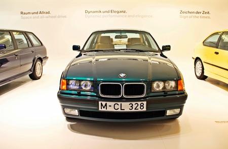bmw: Munich, Germany - April 12, 2012: Display of green  BMW 325, year 1996 at BMW Welt in Munich, German