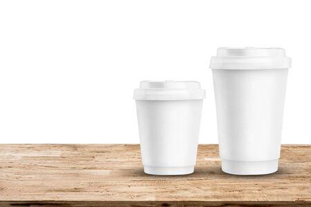 mockup paper coffee cups on light brown wood table Reklamní fotografie