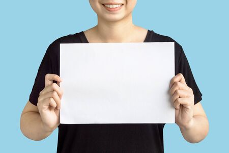 women holding blank paper isolated on light blue background with clipping path Reklamní fotografie