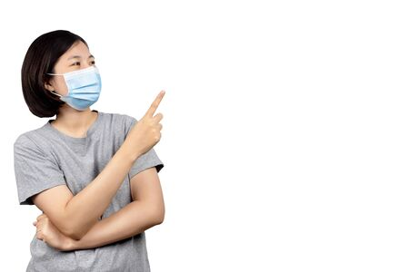 asian women wearing protection medical masks to prevent corona virus and hand pointing to copy space isolated on white background