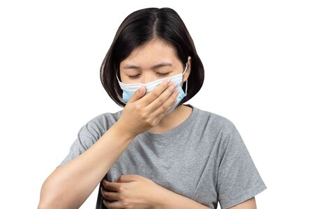 asian women wearing protection  medical masks to prevent corona virus and hands holding her mouth and chest to cough sneeze  isolated white background